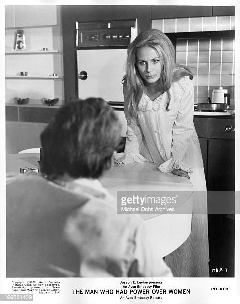 Penelope Horner leaning against counter in a scene from the film 'The Man Who Had Power Over Women' 1970