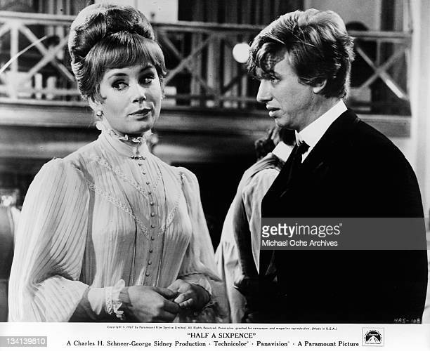 Penelope Horner looking away from Tommy Steele sitting at the dining table together in a scene from the film 'Half A Sixpence' 1967