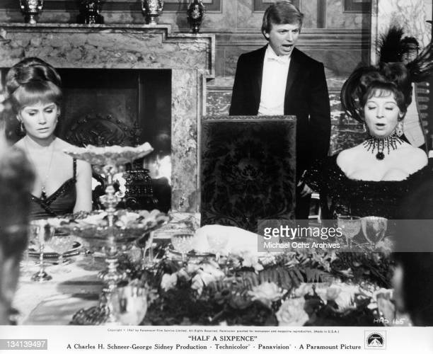Penelope Horner looking down at the table as Tommy Steele shouts in a scene from the film 'Half A Sixpence' 1967