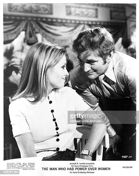 Penelope Horner looking over her shoulder at Rod Taylor in a scene from the film 'The Man Who Had Power Over Women' 1970