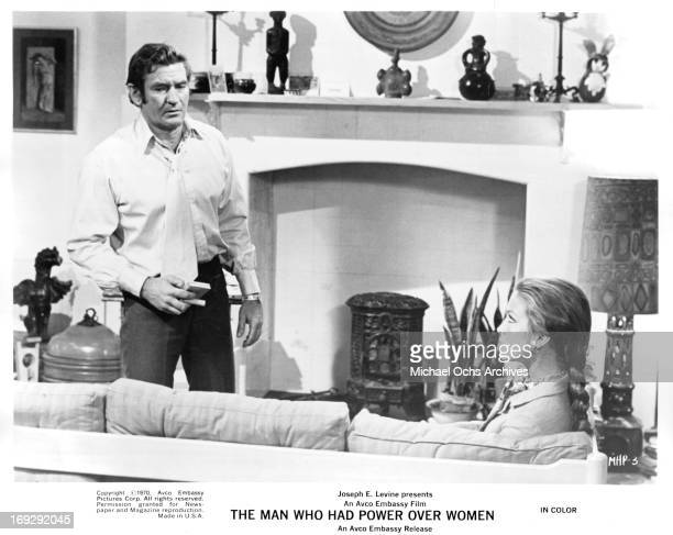 Penelope Horner staring up at Rod Taylor from couch in a scene from the film 'The Man Who Had Power Over Women' 1970
