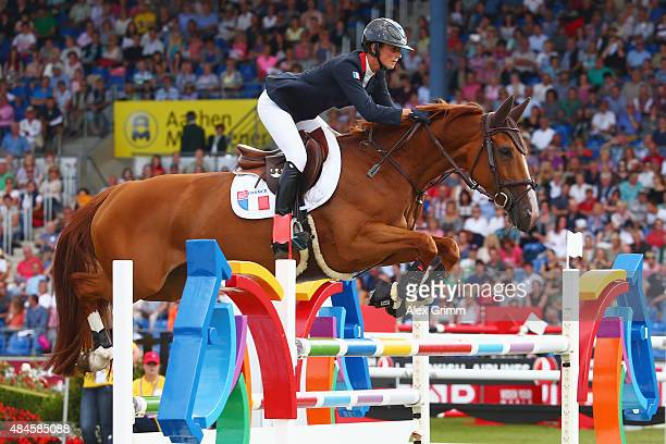 Penelope Leprevost of France competes on her horse Flora de Mariposa during the MercedesBenz Prize Team Show Jumping competition on Day 9 of the FEI...