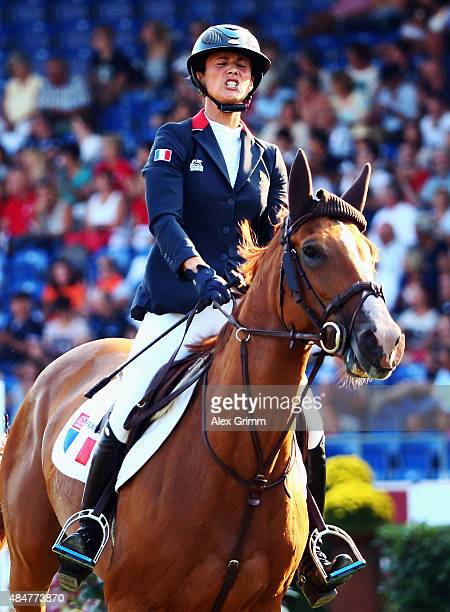 Penelope Leprevost of France reacts on her horse Flora de Mariposa after competing in the second round of the MercedesBenz Prize Show Jumping team...