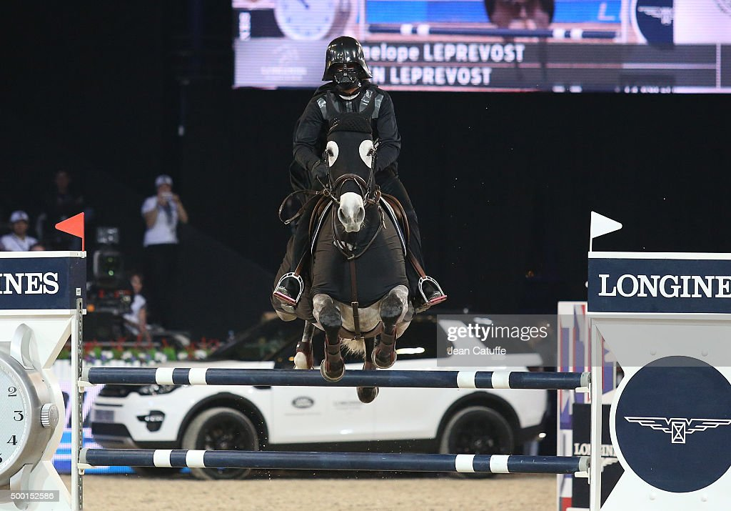 Penelope Leprevost of France rides as Darth Vader during the 'Style and Competition' show jumping charity event benefitting 'AMADE' on day three of the Longines Paris Masters 2015 held at the Paris-Nord Villepinte Exhibition Center on December 5, 2015 in Villepinte nearby Paris, France.
