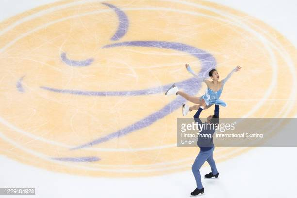 Peng Cheng and Jinyang of China participate in pre-match training on day one of the ISU Grand Prix of Figure Skating Cup of China at Huaxi Sports...