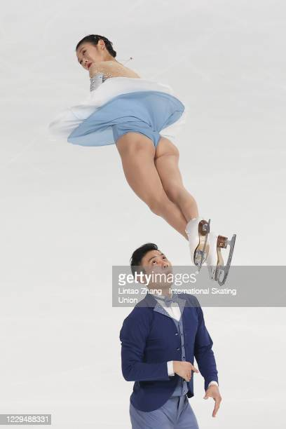 Peng Cheng and Jinyang of China performs during the Pairs Short Program on day one of the ISU Grand Prix of Figure Skating Cup of China at Huaxi...