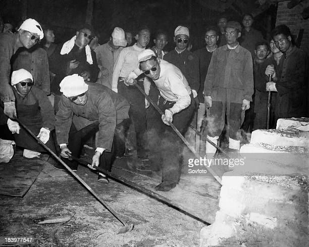 Peng Hsiaochien deputy governor of Hunan province smelting steel in steel works run by provincial government China December 1958 Great Leap Forward...