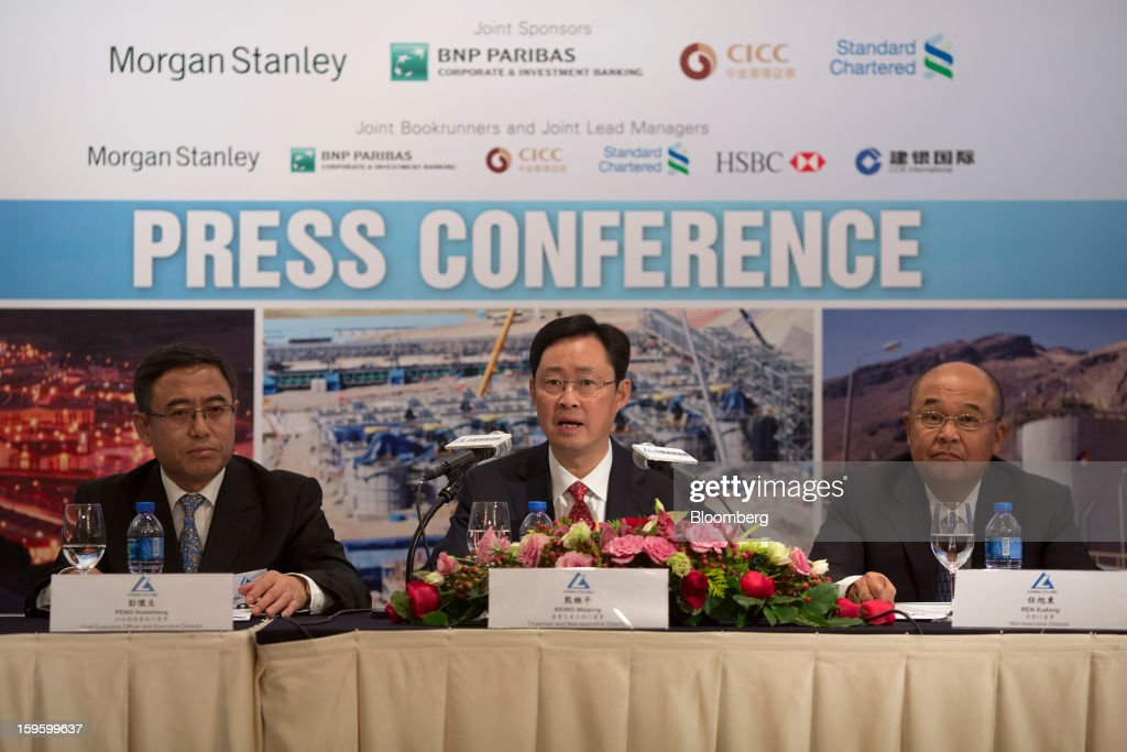 Peng Huaisheng, chief executive officer of Chinalco Mining Corp. International, from left, Xiong Weiping, chairman of Aluminum Corp. of China Ltd. (Chinalco) and Chinalco Mining Corp. International, and Ren Xudong, vice president of Aluminum Corp. of China Ltd. (Chinalco), attend the Chinalco Mining's initial public offering news conference in Hong Kong, China, on Thursday, Jan. 17, 2013. Chinalco Mining, a unit of China's biggest aluminum producer, plans to raise as much as $435 million in an initial public offering in Hong Kong to fund its copper project in Peru. Photographer: Jerome Favre/Bloomberg via Getty Images