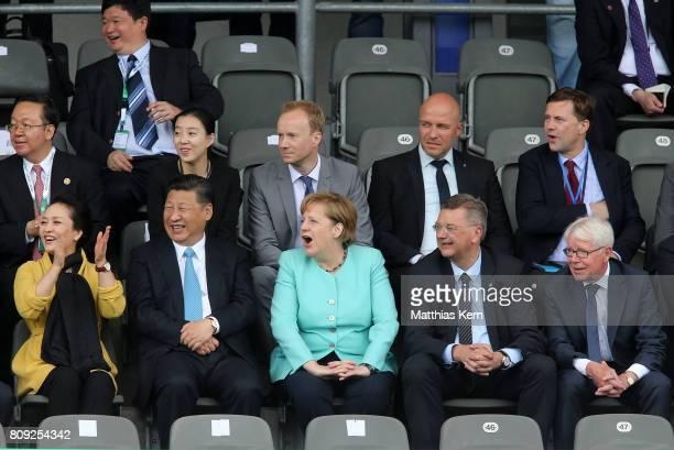 Peng Liyuan, Chinese President Xi Jinping, German Chancellor Angela Merkel , President of the German Football Association Reinhard Grindel and...