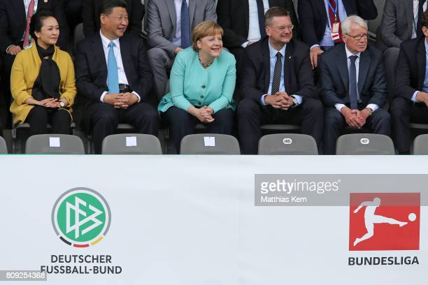 Peng Liyuan Chinese President Xi Jinping German Chancellor Angela Merkel President of the German Football Association Reinhard Grindel and President...
