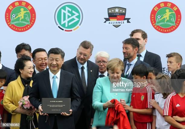 Peng Liyuan, Chinese President Xi Jinping, President of the German Football Association Reinhard Grindel, President of the German Football League...