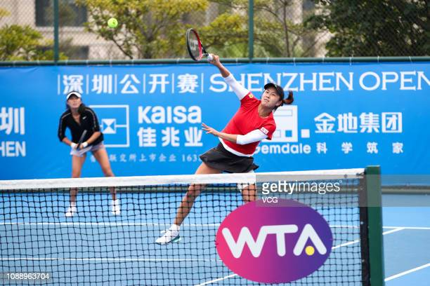 Peng Shuai of China and Yang Zhaoxuan of China return a shot during the women's doubles quarterfinal match against Irina Bara of Romania and Oksana...
