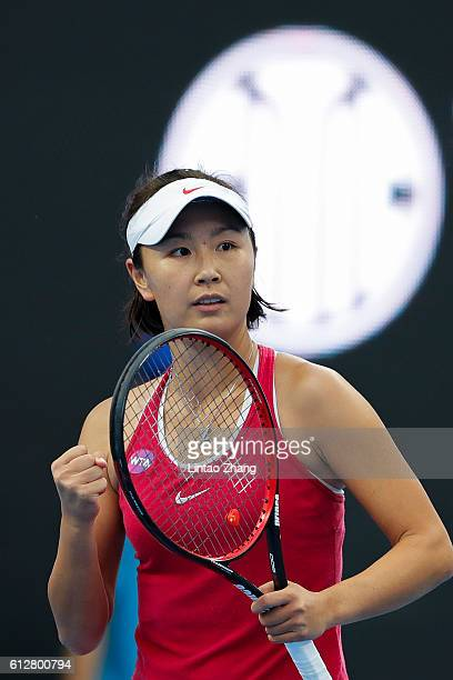 Peng Shuai of China celebrates a point against Caroline Garcia of France during the Women's singles second round match on day five of the 2016 China...