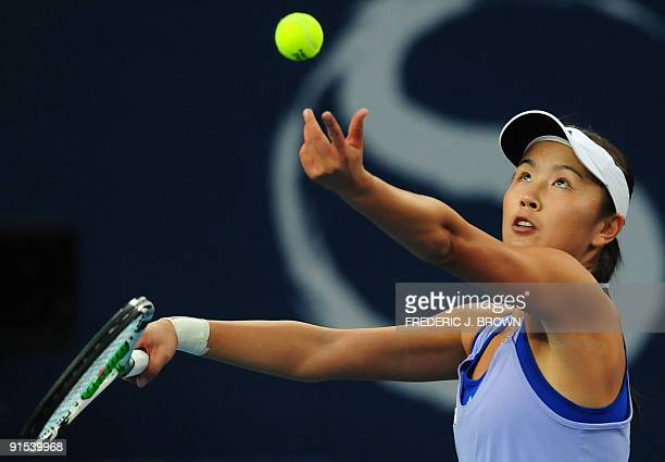 Peng Shuai of China eyes her serve to Maria Sharapova of Russia in their third round match at the China Open in Beijing on October 7 2009 Peng...