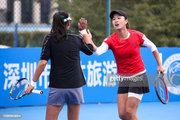 Peng Shuai of China high five Yang Zhaoxuan of China during the women's doubles quarterfinal match against Irina Bara of Romania and Oksana...