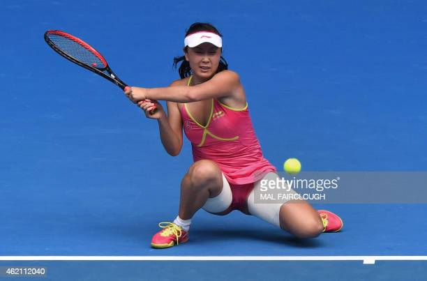 Peng Shuai of China hits a return against Maria Sharapova of Russia in their women's singles match on day seven of the 2015 Australian Open tennis...