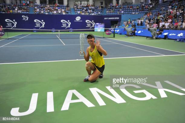 Peng Shuai of China poses with the trophy after defeating Japan's Nao Hibino in the women's singles final at the Jiangxi Open WTA tennis tournament...