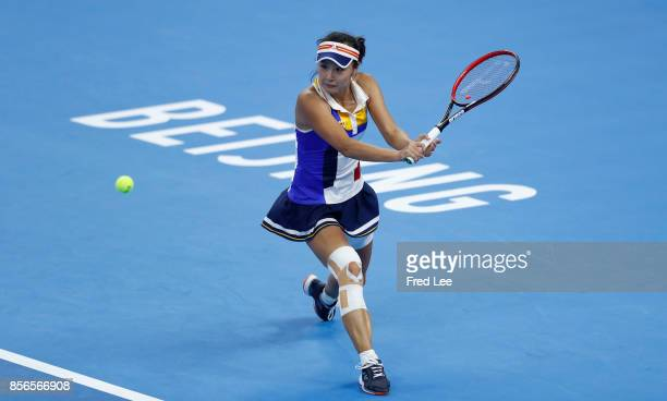 Peng Shuai of china returns a shot against shelby Rogers of United States during the Women's singles first round match on day three of the 2017 China...