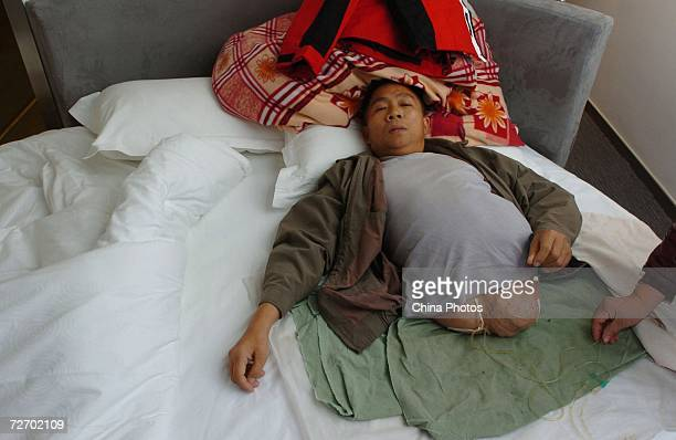 Peng Shuilin lies in the bed at a hotel December 2 2006 in Beijing China Peng Shuilin was hit by a freight truck in a traffic accident in 2004 and...