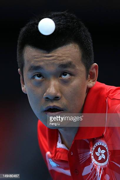 Peng Tang of Hong Kong serves in his Men's Singles Table Tennis second round match against Noshad Alamiyan of Iran on Day 2 of the London 2012...