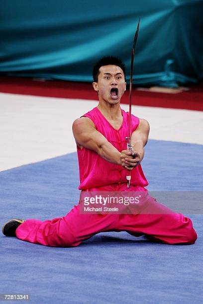 Peng Wei Chua of Chinese Taipei competes in the Men's Nanquan Three Events Combined Nandao at the 15th Asian Games Doha 2006 at the Aspire Hall on...
