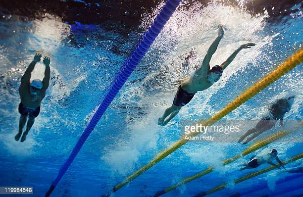 Peng Wu of China Michael Phelps of the United States and Takeshi Matsuda of Japan compete in the Men's 200m Butterfly Final during Day Twelve of the...