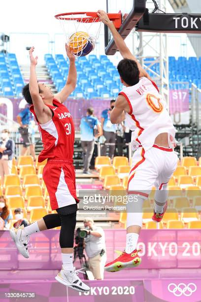 Peng Yan of Team China slam dunks the ball in the 3x3 Basketball competition on day four of the Tokyo 2020 Olympic Games at Aomi Urban Sports Park on...