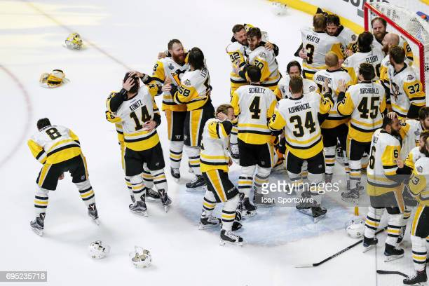 Penguins players celebrate after winning the 2017 NHL Stanley Cup Finals between the Pittsburgh Penguins and Nashville Predators on June 11 at...