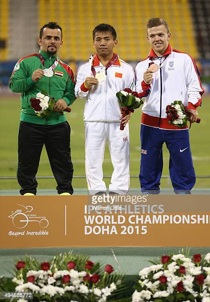 Pengxiang Sun of China poses with his gold medal, Kovan Abdulraheem of Iraq silver and Kyron Duke of Great Britain bronze for the men's javelin F41...