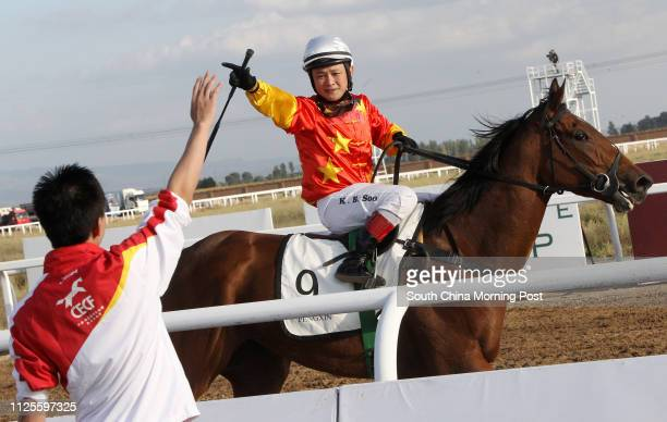 RACE 8 Pengxin National Breeders Cup winner Horse Beat of the Drum and Jockey Soo Khoon Beng at 2013 China Equine Cultural Festival at Hohhot Inner...