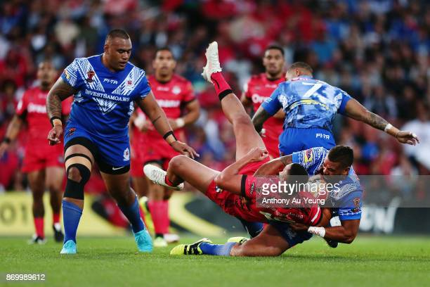 Peni Terepo of Tonga is tackled by Frank Pritchard of Samoa during the 2017 Rugby League World Cup match between Samoa and Tonga at Waikato Stadium...