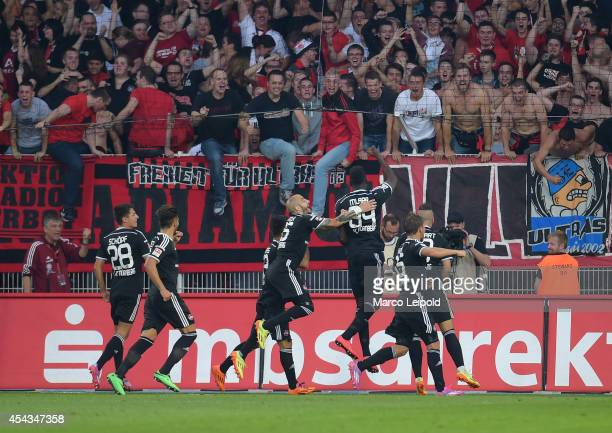 Peniel Kokou Mlapa celebrates with his team mates after scoring the third goal during the game between 1 FC Union Berlin and 1 FC Nuernberg on August...