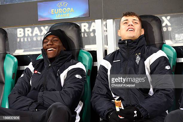 Peniel Mlapa and Granit Xhaka of Moenchengladbach sit on the bench during the UEFA Europa League group C match between Borussia Moenchengladbach and...