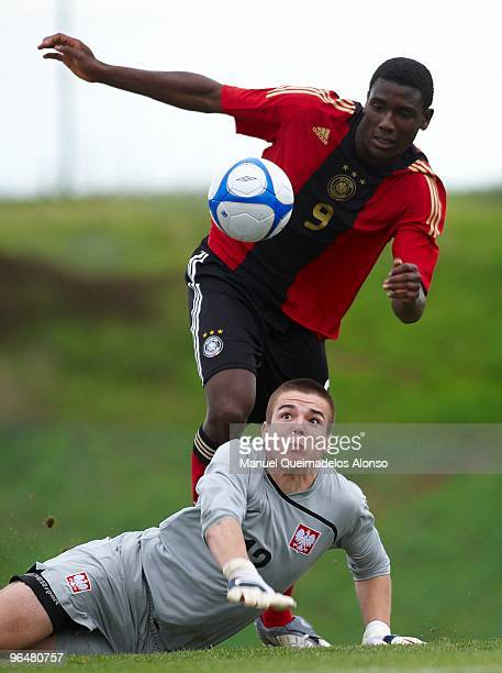 Peniel Mlapa of Germany and Filip Kurto of Poland compete for the ball during the U19 international friendly match between Germany and Poland on...
