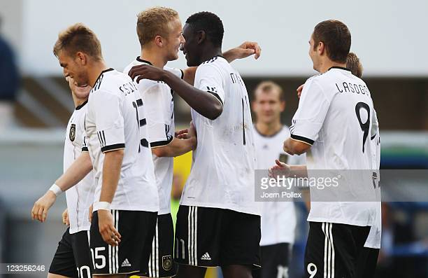 Peniel Mlapa of Germany celebrates with his team mates after scoring his team's fourth goal during the 2013 UEFA European Under21 Qualifier Group 1...