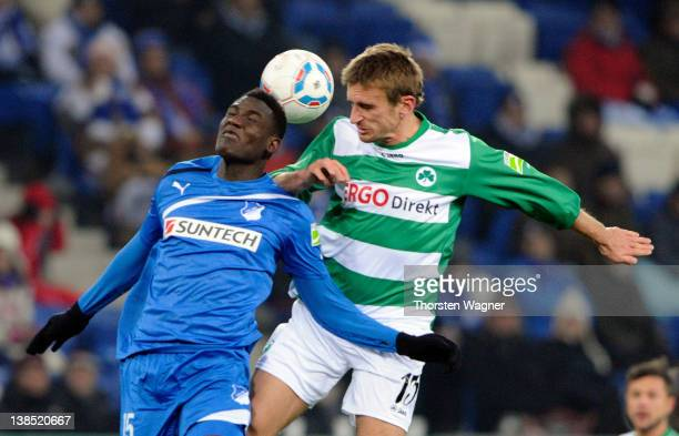 Peniel Mlapa of Hoffenheim battles for the ball with Milorad Pekovic of Fuerth during the DFB Cup Quarter Final match between TSG 1899 Hoffenheim and...