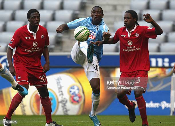 Peniel Mlapa of Muenchen battles for the ball with Georges Mandjeck and Rodnei of Kaiserslautern during the Second Bundesliga match between 1860...