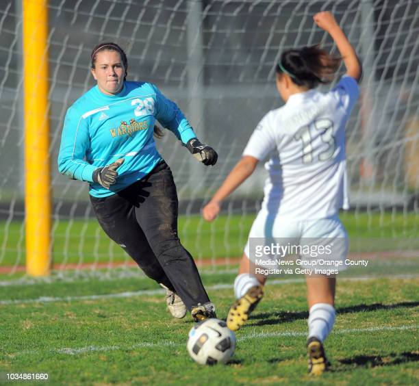 ESTATES Peninsula girls soccer shutout West 50 in a Bay League matchup West goalie Amanda Ornelas moves in to block a shot by Peninsula's Jennifer...