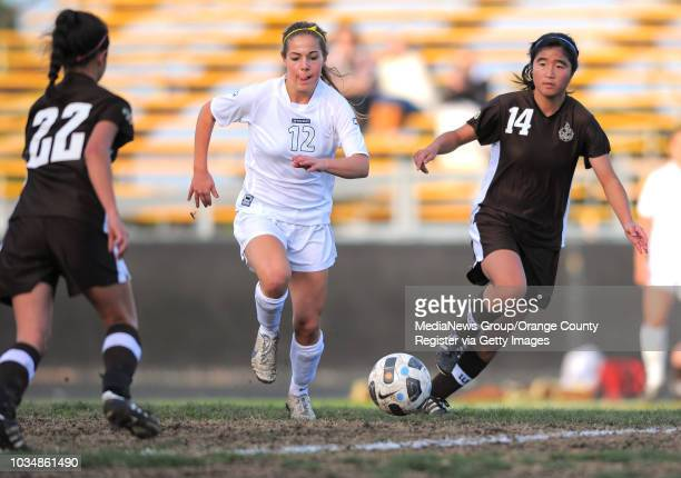 ESTATES Peninsula girls soccer shutout West 50 in a Bay League matchup West's Courtney Shoda and Kelsey Sakamoto try to keep Peninsula's Michelle...