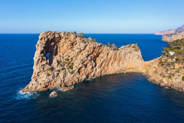 Peninsula Sa Foradada with rockhole, near Deia, Serra de Tramuntana, drone shot, Majorca, Balearic Islands, Spain