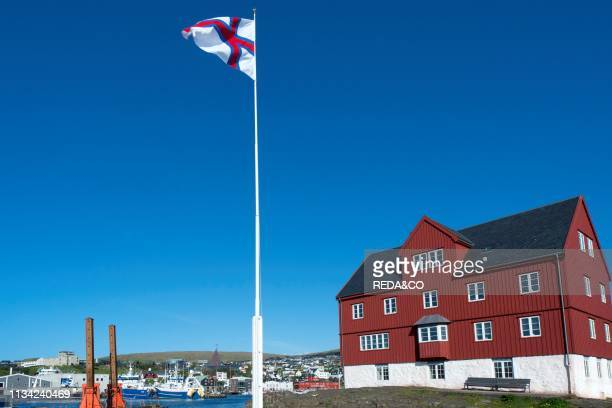 Peninsula Tinganes with old town and the red houses of the government district Torshavn the capital of the Faroe Islands on the island of Streymoy in...
