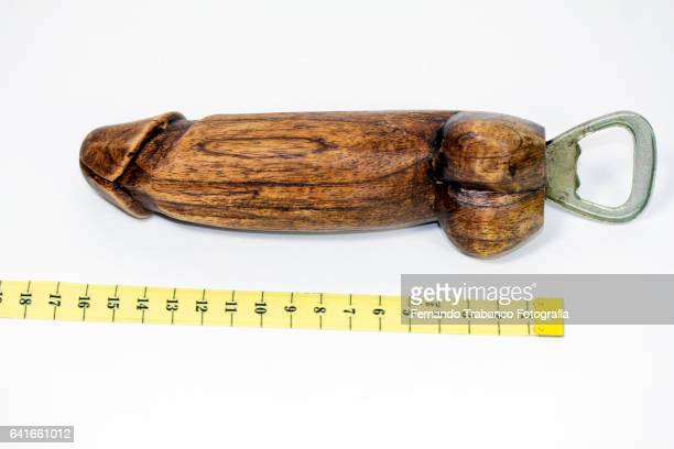 Penis of wood measured with a meter