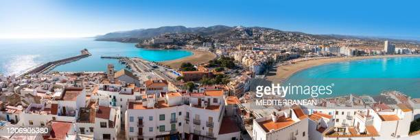 peniscola pesiscola lighthouse beach and village panoramic in castellon - valencia spain stock pictures, royalty-free photos & images