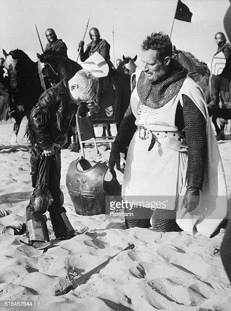 Peniscola, Spain- While his father, actor Charlton Heston, kneels beside him in the sand of the beach at Peniscola, Spain, 6-year-old Fraser Heston...