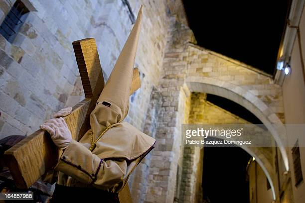 A penitent carries a cross during the Holy Week procession of the Cofradia Jesus Yacente on March 29 2013 in Zamora Spain Easter week is...