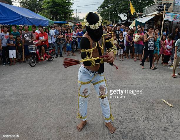 A penitent flagellates himself as part of Lenten observance in Angeles City Pampanga province north of Manila on April 17 2014 The dominant Roman...