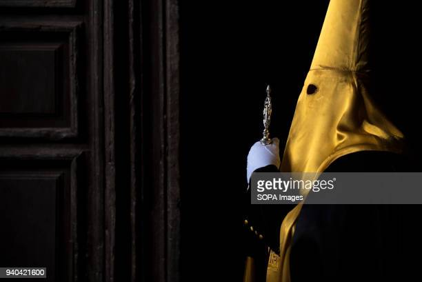 Penitent from La Soledad brotherhood in the Jeronimos Monastery before taking part in the Good Friday procession Every year thousands of christians...