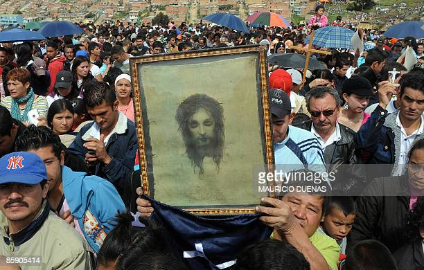 A penitent holds an image of Christ to be blessed during the Via Crucis procession as part of the Good Friday ceremonies on April 10 2009 in the...