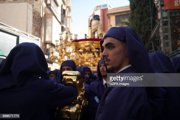 A penitent of Gitanos brotherhood looks on as he takes part in a procession during the Holy Week in Málaga The Holy Week in Andalusia is one of the...