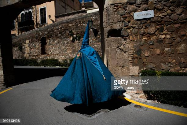 A penitent of 'Santa María de la Alhambra' brotherhood before taking part in the Holy Saturday Procession in Granada Every year thousands of...